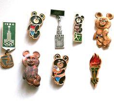 Set of 8 Badges / Pins - 1980 Moscow Olympics - Bear Mascot Misha Torch Flame - Communist Sports Propaganda - from Russia / Soviet Union. $29.00, via Etsy.