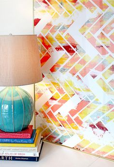 love the lamp and the print: 1) Paint the canvas all crazy like 2) Use painter's tape to create a herringbone pattern with some missing 3) Paint over the canvas in white 4) Remove tape and voila!..