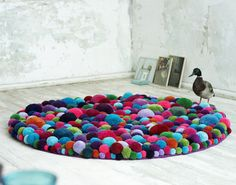 DIY Tutorial-wonderful & colorful pom pom rug! This is cool and all..... But why is a duck there