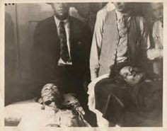 Bonnie and Clyde at funeral parlor.The mob was horrible.One man was even getting ready to cut off Clyde's trigger finger.People were cutting off peice of their clothes and They also were cutting off Bonnie's hair for keepsakes ect.Pretty sick people.