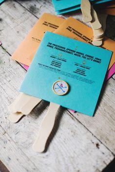 paper programs with a badge, photo by Altmix Photography http://ruffledblog.com/modern-atlanta-wedding #weddingideas #papergoods