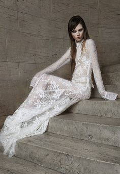 Look 4. Ivory Chantilly lace shirtwaist gown with hand appliqué corded lace. Hand embroidered pearl and crystal grosgrain belt.