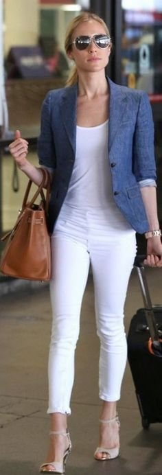 Who made  Kristin Cavallaris brown tote handbag, nude wedge sandals, white skinny jeans, and blue denim jacket that she wore at LAX airport?