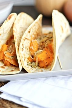 Quick vegetarian taco recipe with roasted butternut squash, caramelized onions, sage and parmesan cheese. The butternut squash can also double as a side.