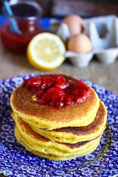 Lemon Cornmeal Pancakes with Strawberry Sauce via @Jenna (Eat, Live, Run)
