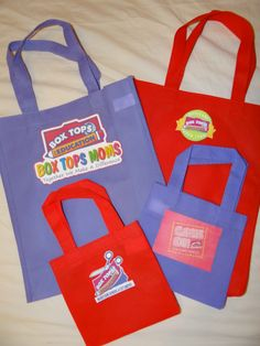 A great use of smaller recycle bags from the dollar store.  Iron on logo's make all the difference~ and great for prize bags too!