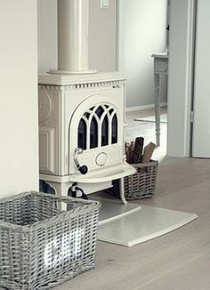 This is like our wood stove however, we have the black pipe coming out of it. So excited to think about painting it!