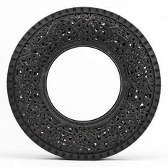hand-carved car tires by Belgian artist Wim Delvoye. The collection of tires features intricate pattern work with various motifs, like floral and Art Deco.