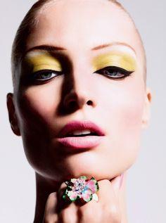 Strong yellow eyeshadow & black eyeliner