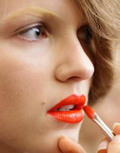 Prada  S/S 2012 - Orange lips and bleached brows #bleachedeyebrows #noeyebrows