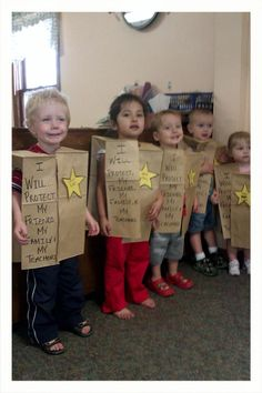"police vests for the preschool class. Lesson= safety and/or jobs people do!!...it's just a paper bag, you cut up the middle and make a hole for their arms and neck then place a badge with ""officer (name)"""