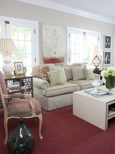 Update a classic chair with contemporary fabric, like the polka dot print used on this Louis XV chair. A confident mix of vintage pieces with modern textiles defines this living room designed by Claire Watkins.