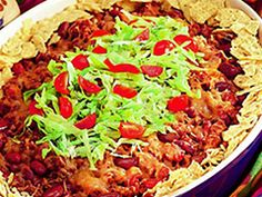 Taco Bake-- Ingredients  1 pkg. Jimmy Dean® Hot Pork Sausage Roll  1 cup chopped onion  2 cans (14 ½ ounces each) diced tomatoes, undrained  1 can (15 ounces) kidney beans, drained, rinsed  ½ cup water  1 pkg. (1 ¼ ounces) taco seasoning mix  10 cups restaurant-style tortilla chips (10 ounces), coarsely broken  2 cups (8 ounces) shredded cheddar cheese  Sour cream and chopped fresh cilantro for serving (optional)