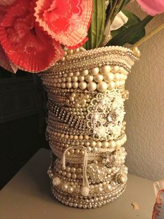 How cool would it be to make this? Find cheap jewelry at garage sales and a vase, Would make a beautiful centerpieces for weddings.