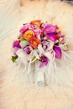 Purple and Orange Wedding Bouquet with Feathers