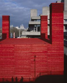 Architecture firm Haworth Tompkins installed a bright red auditorium amongst the brutalist concrete of London's National Theatre