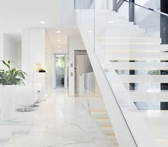 White and modern House M in Italy by Monovolume Architecture + Design _