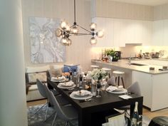 The Modo Chandelier at the 2012 ELLE DECOR Modern Life Concept House in NYC. Dining room and kitchen designed by Sherrill Canet.