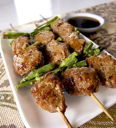 Japanese food Tsukune - chicken meatballs with grilled asparagus.