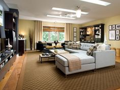 Candice Olsen chose a mostly neutral palette of deep browns, cool creams and inky charcoals for this living room.