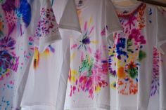 Sharpie tie dye. First decorate with sharpie pen the spray with rubbing alcohol. Great girl scout idea without the big mess