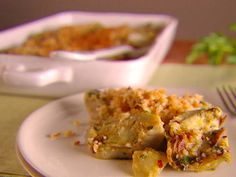 Food Network invites you to try this Artichoke Gratinata recipe from Giada De Laurentiis.