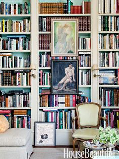 A portrait of conductor Leopold Stokowski and a figure study are focal points on the library bookshelf. Design: Alex Hitz