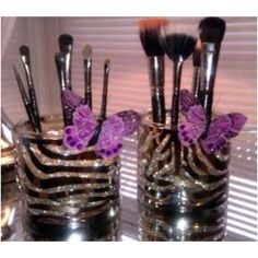 DIY makeup brush holder using bath and body works candle jars and their candle jar holders. Fill with glass beads. So cute!