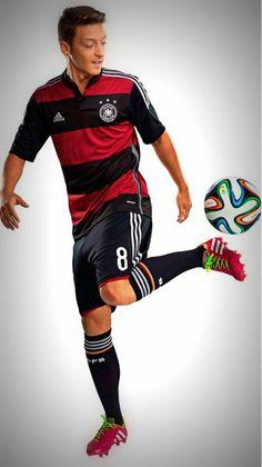 Mesut Özil modelling the 2014 Germany Away Kit