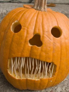 If you want to bring an extra scary element to your jack-o'-lantern, use an array of scattered toothpicks as sharp and scraggly teeth. #jackolantern #halloween #diy #pumpkin #carving #toothpicks #ideas #crafts #fall