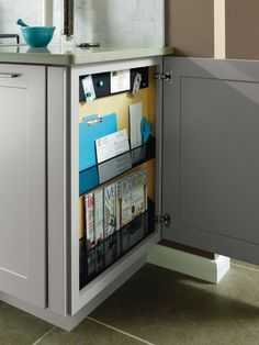 Diamond Cabinets Base Message Center wins an #ADEX Platinum Award! The Base Message Center is a place to unload clutter and #organize behind closed doors. It includes magazine and mail holders and a bulletin board.