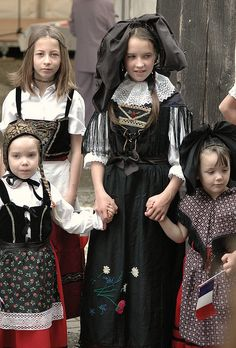 Four young lasses in elegant traditional clothing from Alsace. #French #France #kids #traditional #costume #clothing #folk #dress #travel