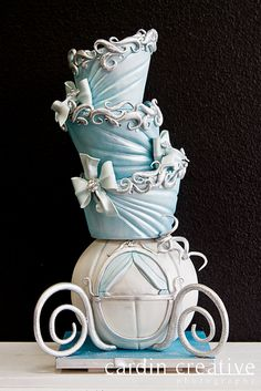 Topsy Turvey Cinderella Carriage disney Wedding Cake - Cinderella Wedding Cake…I bet it disappeared after midnight! Made by 'Gimme Some Sugar' of Las Vegas. Check em out if you're looking for a custom wedding cake!