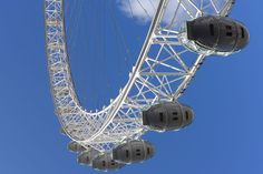 Looking up at the observation capsules of the London Eye Ferris wheel