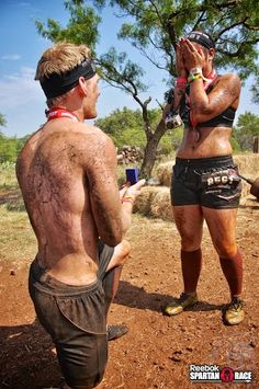 Who would've thought getting engaged in the mud and dirt would be so cute?! Love this proposal at the Spartan Sprint!