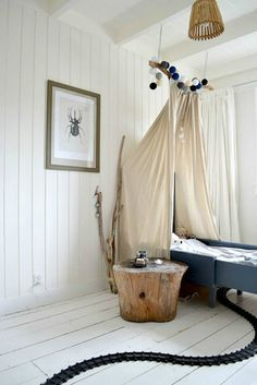 Painted white wood and a lovely canopy bed. #kids #decor