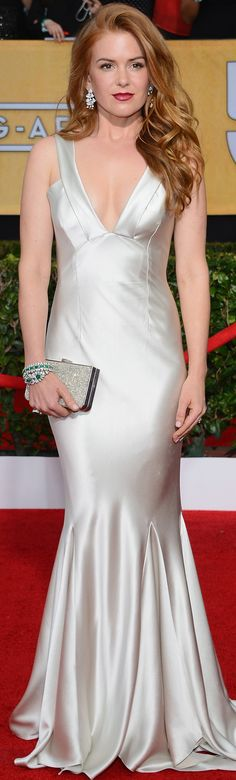 Isla Fisher at the SAG Awards in an Oscar de la Renta silver satin gown
