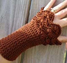 http://www.etsy.com/listing/87826168/armwarmers-in-chocolate-brown-hand?ref=tre-2073023822-3
