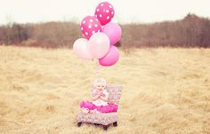 First Birthday Girl balloons in field. Baby Photography.