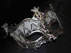 Silver and Rhinestone Metallic Masquerade Mask. $65.00, via Etsy.