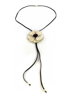 This exquisite necklace is the epitome of less is more. A single, beautiful flower with eight delicate tagua petals. Slides on a string of brown faux suede with an adjustable length of twenty inches. Can be worn as a regular necklace or a fashionable choker. This tagua necklace is fair trade and ethically handmade in Colombia using eco friendly dyes. tagua necklac, exquisit necklac
