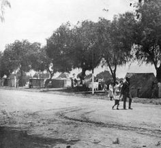 Migrant worker's camp at Bonner Fruit and Cannery, on the east side of Lankershim Boulevard, looking north from the railroad, 1915. The Bonner Fruit & Canning Company was owned by Guy Weddington, who employed about 250 people for his summer picking crews. Weddington Family Collection. San Fernando Valley History Digital Library.