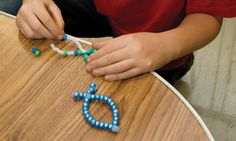http://www.childrensministry.com/articles/fish-napkin-holder  Preteens can make these napkin rings to use at their families' Easter dinner.