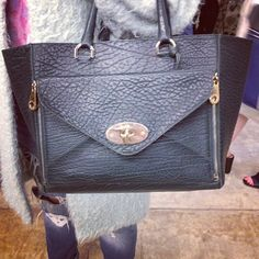 Mulberry bags were out in force at London Fashion Week. www.handbag.com