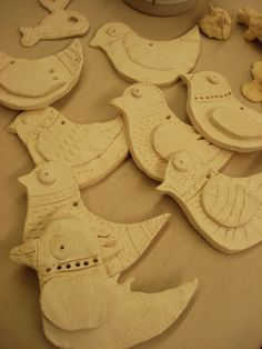 Clay birds made using a bird cookie cutter. Kids add wing and designs to show what they've seen during their Big Garden or Big Schools' #Birdwatch #pinittowinit