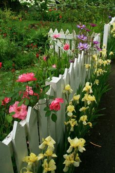 .grrreat pin showing how flowers and a 3 foot picket fence along front yard (and maybe all sides) can give dramatic curb  appeal to your home!!!!!!!!!!