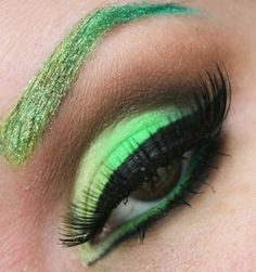 Green eye shadow. But not so sure about the eye brow color.