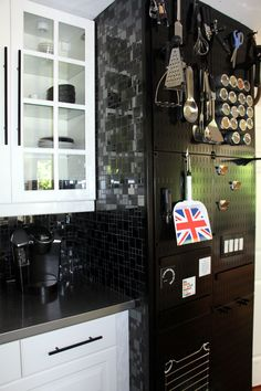Kitchen remodel with Pegboard! Kitchen pegboard is great for pots and pans and with Wall Control metal pegboard all your magnetic accessories will work on the wall too! Wall Control takes Julia Child style pegboard to a whole new level of chic and stylish!