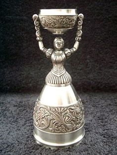 Traditional German Wedding Cup:  The cup design enables the bride and groom to symbolically take their first drink as man and wife from the same cup.