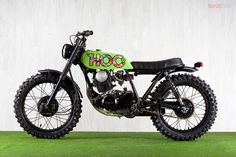 This little Yamaha SR250 scrambler was built by Spain's Ad Hoc Cafe Racers. Cheeky, no?